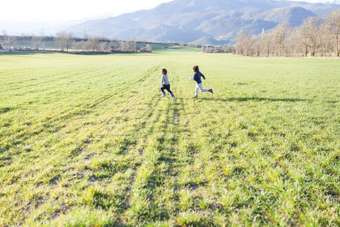 Two boys running in a field - VABF000415