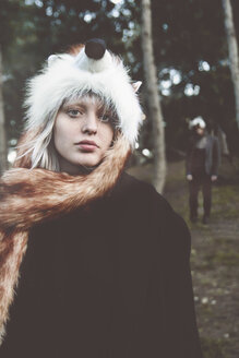 Portrait of young woman wearing fox hat in the woods - RTBF000072