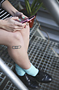 Legs of young woman with tatoo - RTBF000084