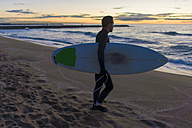 Surfer with his board on the beach at sunrise - SKCF000081