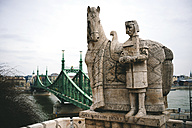 Hungary, Budapest, Stone sculpture of Saint Stephen and Liberty bridge - GEMF000839
