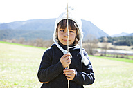 Portrait of cross-eyed little boy with stick - VABF000419