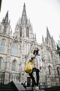 Spain, Barcelona, young woman at Barcelona Cathedral - JRFF000527