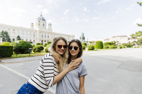 Austria, Vienna, two young women embracing at Museum of Art History - AIF000303