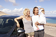 Spain, Fuerteventura, Jandia, happy family with car at the coast - MFRF000596