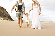 Spain, Fuerteventura, Jandia, family walking on beach - MFRF000605