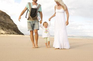 Spain, Fuerteventura, Jandia, family walking on beach - MFRF000605
