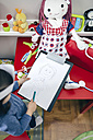 Top view of little girl drawing her doll - DAPF000083