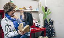 Senior woman and her granddaughter having fun at children's room - DAPF000092