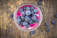 Glass of overnight oats with blueberries and berry juice, close-up - LVF004739