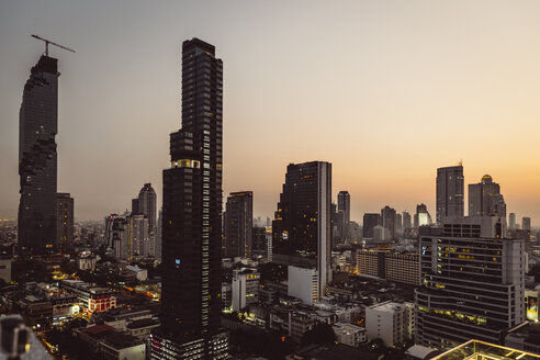 Thailand, Bangkok, Skyline with Maha Nakhon Tower in the evening - MBEF001421