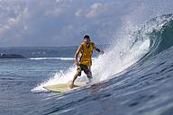 Indonesia, Bali, surfing man - KNTF000275