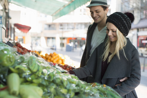 Young couple in love at vegetable stand - LFOF000210