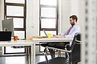 Creative professional working at desk - FKF001804