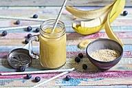 Glass of banana mango smoothie - YFF000537