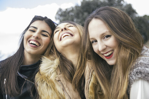 Three laughing young women - ABZF000338