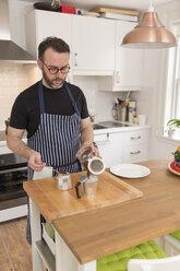 Man preparing espresso in the kitchen - BOYF000260