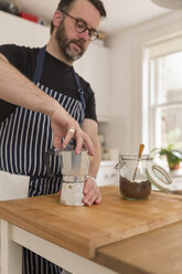 Man preparing espresso in the kitchen - BOYF000263