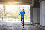 Young sporty man jogging - DIGF000237