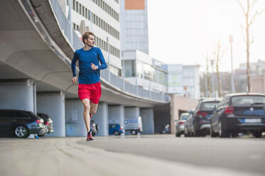 Young sporty man jogging - DIGF000255