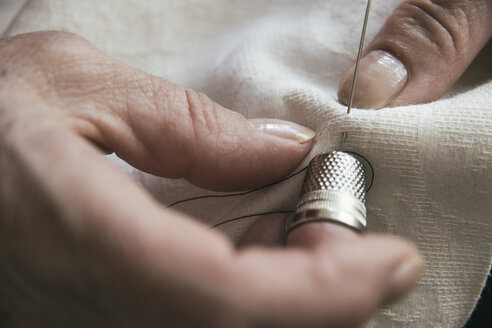 Woman with a thimble sewing - ABZF000351