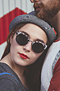 Portrait of young woman wearing sunglasses leaning agaich her boyfriend - RTBF000118