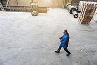 Manager walking through factory hall - DIGF000291