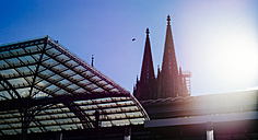 Germany, Cologne, view to church spires of Cologne Cathedral with glass roof in the foreground - DASF000042