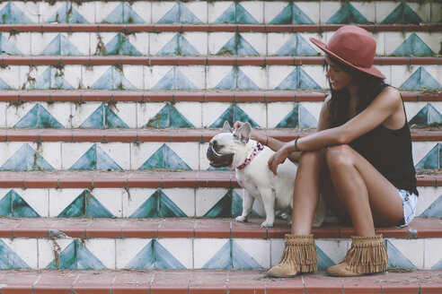 Woman sitting with her dog on stairs - RTBF000132