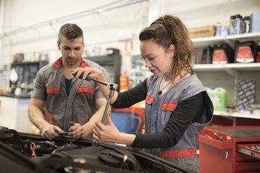 Mechanics working in workshop, reparing car - JASF000661
