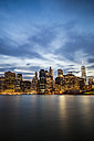 USA, New York City, view from Brooklyn to lighted Manhattan skyline and East River at evening twilight - GIOF000884