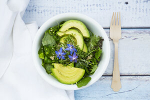 Detox Bowl of different lettuces, vegetables, cress, quinoa, avocado and starflowers - LVF004758