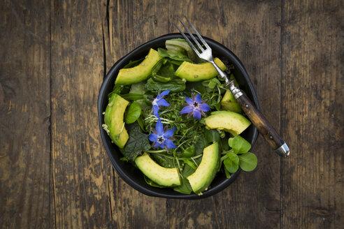 Detox Bowl of different lettuces, vegetables, cress, quinoa, avocado and starflowers - LVF004761