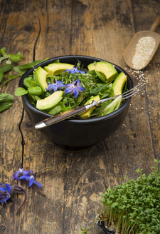 Detox Bowl of different lettuces, vegetables, cress, quinoa, avocado and starflowers - LVF004764