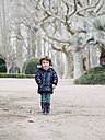 Portrait of smiling little boy standing in park in winter - XCF000079