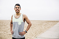 Portrait of smiling athlete on the beach - EBSF001349