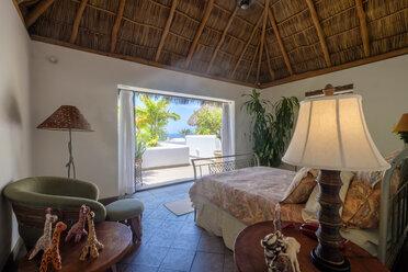 Mexico, Punta de Mita, bedroom in a residential home - ABAF001986