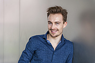 Portrait of smiling young businessman with stubble - DIGF000309