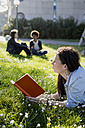 Young woman in park reading book - MAUF000469