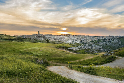 Italy, Basilicata, Matera, Old town, View to Sassi of Matera, Parco della Murgia Materana in the evening - CSTF001042