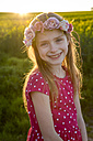 Portrait of smiling girl with wreath of flowers in a rape field - SARF002699