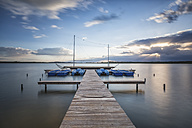 Germany, Lake Rangsdorf, jetty at sunset - ASCF000577