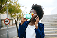 Young woman with coffee to go telephoning with smartphone - KIJF000343