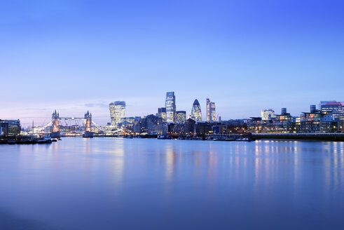 UK, London, skyline with River Thames and Tower Bridge at blue hour - BRF001345