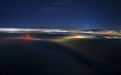 USA, San Francisco, Golden Gate bridge in fog at night - STCF000212