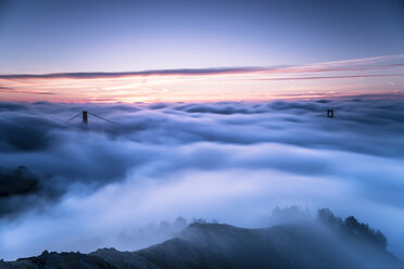 USA, San Francisco, Golden Gate bridge in fog at sunrise - STCF000215