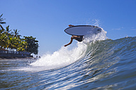 Indonesia, Bali, surfer on wave - KNTF000278