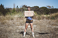 Hippie holding 'I love you' sign in the nature - GIOF000904