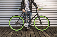 Young man with fixie bike - RAEF001109