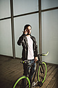 Young man with fixie bike - RAEF001112